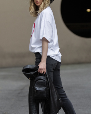 Girl wearing black skinny jeans and an oversized white tshirt form The Foreign Sun.