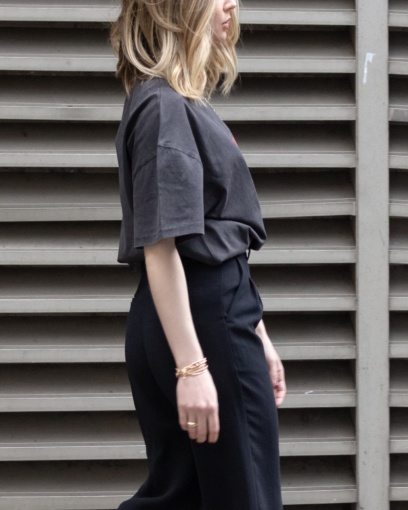 Girl wearing a boxy vintage wash tshirt from The Foreign Sun.